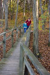 A brother and sister on a nature walk at Massachusetts Audubon Society's Arcadia Wildlife Sanctuary in Northampton, Massachusetts.