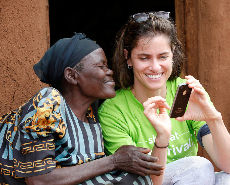Actor Amanda Peet shares a moment with a village elder in Kenya's Migori County, during a trip by the United Nations Foundation's Shot@Life campaign, August 6, 2013. Governments and partnerships are currently moving to tackle a polio outbreak in the Horn of Africa. (Insider Images/Stuart Ramson for the UN Foundation)