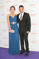 Peter Andre; Emily Macdonagh, The Caudwell Children Butterfly Ball, Grosvenor House Hotel, London UK, 15 May 2014, Photo by Richard Goldschmidt