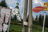 MEDZILABORCE, SLOVAKIA - SEPTEMBER 5, 2018: Signs for a local hotel and a street both named for Andy Warhol, outside the Andy Warhol Museum of Modern Art on Wednesday, September 5, 2018 in Medzilaborce, Slovakia. Andy Warhol's parents were both born in the nearby village of Mikova, and married there before separately moving to America and giving birth to their famous son. CREDIT: Brendan Hoffman for The New York Times