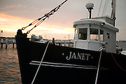 "USA, Newport, RI - Trap fighing boat ""Janet"" weathers a winter snow at Bowen's Wharf."