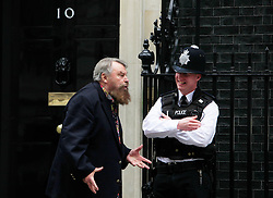 © Licensed to London News Pictures 24/04/2013.Actor Brian Blessed shares a joke with a police officer outside Downing Street, after joining NAVS (National Anti-Vivisection Society) in delivering a petition, calling for less secrecy in animal laboratories, on World Day for Laboratory Animals..London, UK.Photo credit: Anna Branthwaite/LNP