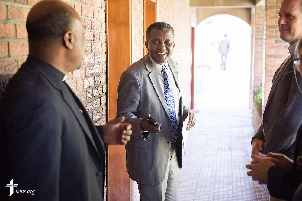 The Rev. Dr. Berhanu Ofgaa, general secretary of the Ethiopian Evangelical Church Mekane Yesus, greets the Rev. Dr. Tilahun Mendedo, president of Concordia College, Selma, Ala., at the Mekane Yesus Seminary on Monday, Nov. 10, 2014 in Addis Ababa, Ethiopia. To the right is the Rev. Shauen Trump, area director for Eastern and Southern Africa. LCMS Communications/Erik M. Lunsford