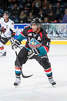 KELOWNA, CANADA - OCTOBER 22: Tyrell Goulbourne #12 of the Kelowna Rockets skates against the Calgary Hitmen on October 22, 2013 at Prospera Place in Kelowna, British Columbia, Canada.   (Photo by Marissa Baecker/Shoot the Breeze)  ***  Local Caption  ***