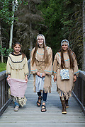 K'BEQ - The Sovereign Nation of The Kenaitze<br /> from left to right are Emilee Wilson (age 12), Denali Bernard (age 14) and Julianne Wilson (age 19)<br /> <br /> All three live in Kenai, Alaska.  All three have been involved in the Kenaitze Indian Tribe&rsquo;s Yaghanen Youth Programs since they were in 1st grade.  They have participated in Yaghanen&rsquo;s Native Youth Olympics team, Jabila&rsquo;ina Dance group, Del Dumi drum group and summer culture camps.  Denali states that she enjoys being involved in the programs because they are fun and she gets to meet new friends. <br /> <br /> The dresses would have been traditionally made with caribou skins but the ones that the girls are wearing in the photo are replicas made from pig skin.  The fur around the neck is sea otter.  The dance group was given its&rsquo; name by one of our Kenaitze Elders that has long passed.  The name Jabila&rsquo;ina means People of the Rainbow and is to signify that our group is made up from youth from all cultural backgrounds.  Because of this we allow our youth to wear head dresses from their individual cultures if they wish.  The Wilson girls are Dena&rsquo;ina Athabaskan and Denali is of Inupiaq descent.  The head dresses that they are wearing have traditionally within our dance group, signified that a girl has made the transition into womanhood.  The cloths that they are holding are used only when dancing and only by the women. <br /> <br /> Photographer: Christina Sjogren<br /> <br /> Copyright 2018, All Rights Reserved