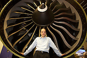 Writer Alain de Botton leans against a giant jet engine of manufacturer CFM during the the Paris Air Show exhibition at Le Bourget and while researching his book, The Pleasures and Sorrows of Work (Hamish Hamilton 2009).
