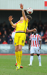 Plymouth Argyle's Dominic Blizzard and Cheltenham Town's Joe Hanks challenge for the high ball.  - Photo mandatory by-line: Nizaam Jones - Mobile: 07966 386802 - 28/03/2015 - SPORT - Football - Cheltenham - Whaddon Road - Cheltenham Town v Plymouth Argyle - Sky Bet League Two