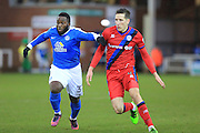 Junior Morias challenges Jim McNulty during the EFL Sky Bet League 1 match between Peterborough United and Rochdale at London Road, Peterborough, England on 25 February 2017. Photo by Daniel Youngs.