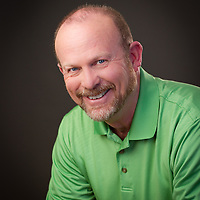 Relaxed headshot in green shirt, Pettepiece Headshots, Pettepiece Photography, Olympia Tacoma Seattle, Portland