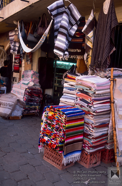 Blankets and clothing for sale in market area, Nogales, Sonora, Mexico..©1990 Edward McCain. All rights reserved. McCain Photography, McCain Creative, Inc.