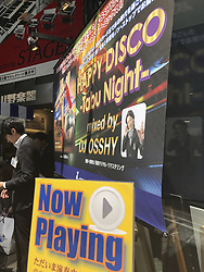 May 23, 2017 - Tokyo, Japan - A sales person stand near a Music CDs store in the Ginza District in Tokyo Japan during a sale of a Japanese DJ who mixes Disco Music. May 23, 2017. Photo by: Ramiro Agustin Vargas Tabares (Credit Image: © Ramiro Agustin Vargas Tabares via ZUMA Wire)