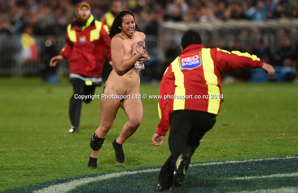 A female streaker invades the pitch. New Zealand All Blacks versus Argentina Pumas. The Rugby Championship. Rugby Union Test Match. McLean Park, Napier. New Zealand. Saturday 6 September 2014. Photo: Andrew Cornaga/www.Photosport.co.nz