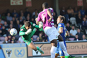 James Shea (Goalkeeper) of AFC Wimbledon takes a battering from John Akinde during the Sky Bet League 2 match between AFC Wimbledon and Barnet at the Cherry Red Records Stadium, Kingston, England on 3 October 2015. Photo by Stuart Butcher.