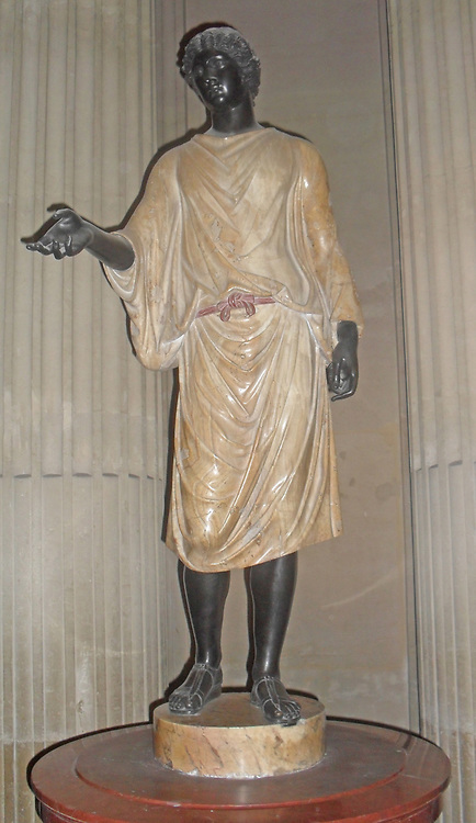 Statue from the Camille Borghese Collection (assistant priest). Made from alabaster, eastern red marble and bronze. Modern head and limbs made from bronze with black patina set on an Ancient body. Entire sculpture varying from between 3rd century BC-3rd century AD. Capitoline Museum. Acquired by Cardinal Scipione Borghese
