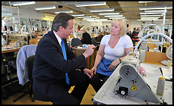 The Prime Minister David Cameron during a visit to David Nieper, UK, April 16, 2012. Photo By Andrew Parsons / i-Images.