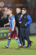 Nick Daws co manager of Scunthorpe and Andy Dawson co manager of Scunthorpe with Paddy Madden of Scunthorpe United at the end of the match during the Sky Bet League 1 match between Scunthorpe United and Colchester United at Glanford Park, Scunthorpe, England on 23 January 2016. Photo by Ian Lyall.