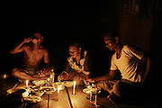"A family sharing dinner by candlelight in Kbal Romeas, one of the villages that will be flooded by the dam's reservoir. Far from cities and towns, most Cambodians lack of electricity. ""They say we're gonna have electricity in the new relocation site but, like many other promises they made, it's just a rumor and no one has ever showed up with an official document to prove it. All we know about the flooding and relocation is just by word of mouth"" - says Keo Meap, community leader of Kbal Romeas, Cambodia."