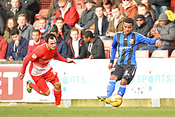 Orient's Chris Dagnall and Swindon's Nathan Byrne  - Photo mandatory by-line: Mitchell Gunn/JMP - Tel: Mobile: 07966 386802 22/02/2014 - SPORT - FOOTBALL - Brisbane Road - Leyton - Leyton Orient V Swindon Town - League One