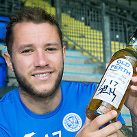 St Johnstone Limited Edition Scottish Cup Final Winners Whisky...03.07.14<br /> St Johnstone's Stevie May pictured with the limited edition 17 year old 'Old Perth' malt whisky to commemorate St Johnstone's first ever Scottish Cup victory on the 17th May 2014<br /> Peter Mackay from Morrison and Mackay<br /> Picture by Graeme Hart.<br /> Copyright Perthshire Picture Agency<br /> Tel: 01738 623350  Mobile: 07990 594431
