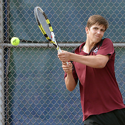 Staff photos by Tom Kelly IV<br /> Radnor's Josh Taylor returns a shot during the second singles match to Unionville's Zack Sokoloff during the District One tennis match between Radnor and Unionville at Unionville High School in East Marlborough Township, Tuesday afternoon.