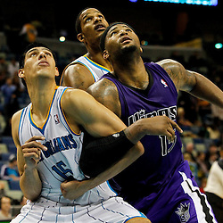 February 6, 2012; New Orleans, LA, USA; New Orleans Hornets power forward Gustavo Ayon (15) and Sacramento Kings power forward DeMarcus Cousins (15) battle for position during the second half of a game at the New Orleans Arena. The Kings defeated the Hornets 100-92.  Mandatory Credit: Derick E. Hingle-US PRESSWIRE
