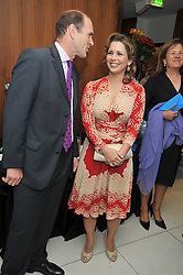 HRH PRINCESS HAYA OF JORDAN and NICK BLOFELD Managing Director of Epsom Downs Racecourse at the launch of the 2009 Derby Festival in the presence of HRH Princess Haya of Jordan in aid of the charity Starlight held at the Kensington Roof Gardens, 99 Kensington High Street, London W8 on 12th May 2009.