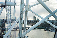 High angle view of the structural supports of the London eye (also known as the Millennium Wheel), the River Thames and the Elizabeth Tower (also known as Big Ben) in London, England.