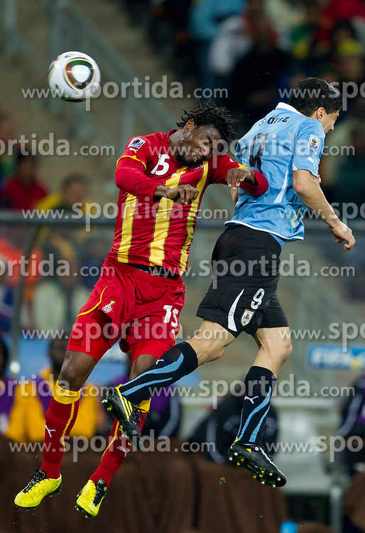 Isaac Vorsah of Ghana vs Luis Suarez of Uruguay  during to the 2010 FIFA World Cup South Africa Quarter Finals football match between Uruguay and Ghana on July 02, 2010 at Soccer City Stadium in Sowetto, suburb of Johannesburg. (Photo by Vid Ponikvar / Sportida)