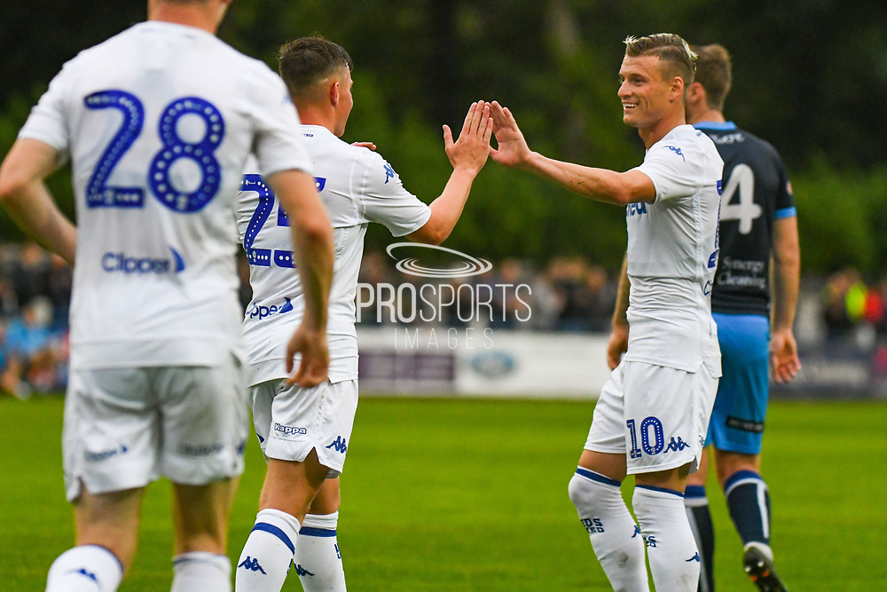 Leeds United Robbie Gotts (25) scores a goal and celebrates with Leeds United Ezgjan Alioski (10) to make the score 0-3during the Pre-Season Friendly match between Tadcaster Albion and Leeds United at i2i Stadium, Tadcaster, United Kingdom on 17 July 2019.