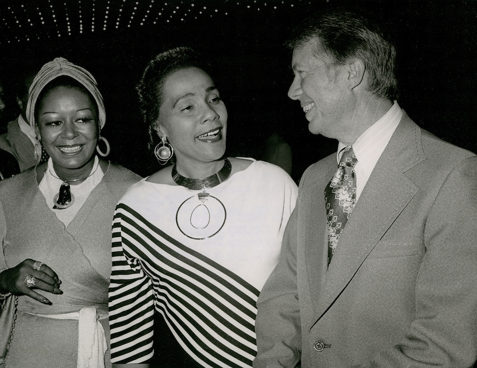 Governor Jimmy Carter of Georgia - a democratic candidate for president - with Coretta Scott King (middle), widow of the late Dr. Martin Luther King, Jr. at an Atlanta civil rights conference.