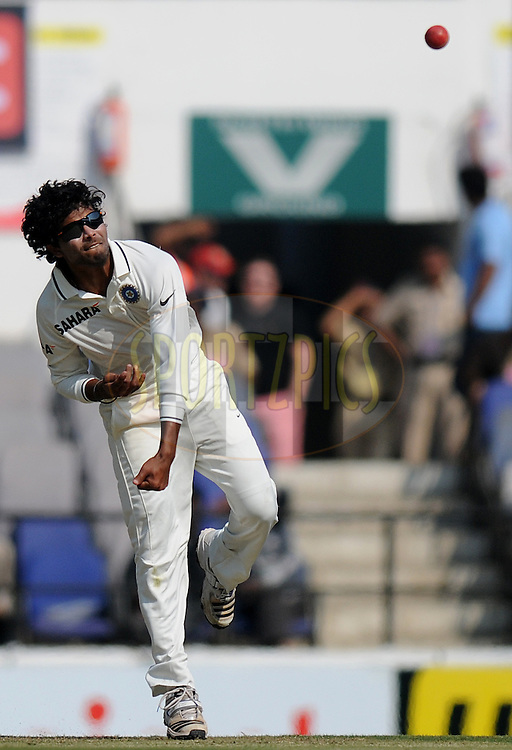 Ravindra Jadeja of India bowls during his bebut match on day one of the 4th Airtel Test Match between India and England held at VCA ground in Nagpur on the 13th December 2012..Photo by  Pal Pillai/BCCI/SPORTZPICS .