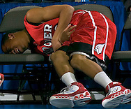 2/11/06 -- Omaha, Ne.San Diego Hoover's Lee Williams writhes in pain on the bench. at The Omaha Shootout, a High School Basketball tournament featuring some of the best prospects at the Qwest Center Omaha...(Photo by Chris Machian/Prarie Pixel Group).