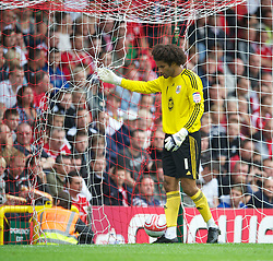 BRISTOL, ENGLAND - Saturday, August 7, 2010: Bristol City's new signing England international goalkeeper David James picks the ball out of the back of the net after Millwall score the second goal during the League Championship match at Ashton Gate. (Pic by: David Rawcliffe/Propaganda)