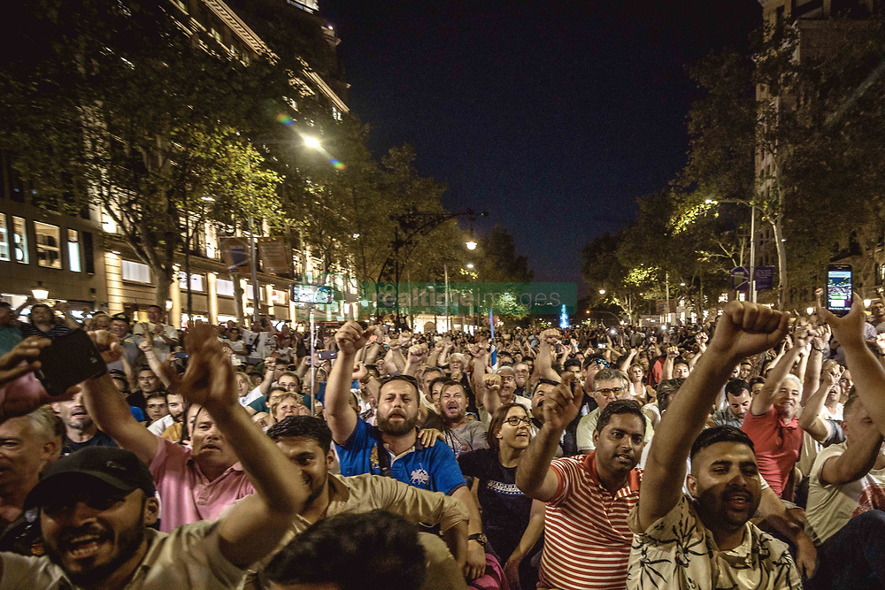 August 1, 2018 - Barcelona, Catalonia, Spain - Gathered taxi drivers shout slogans during an assembly to decide if they put to an end the days lasting block of a neuralgic street in the city centre of Barcelona after the recent governmental offers in response to a protest against the growing use of ride-hailing services (Credit Image: © Matthias Oesterle via ZUMA Wire)