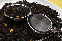 Tea strainer on heap of tea leaves
