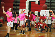 Fans hold up signs for CVU during warm ups before the start of the girls basketball game between the Essex Hornets and the Champlain Valley Union Redhawks at CVU high school on Tuesday night January 26, 2016 in Hinesburg. (BRIAN JENKINS/for the FREE PRESS)