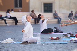 June 21, 2017 - Roma, RM, Italy - People perform Yoga for the International Yoga Day 2017 in Piazza San Silvestro in Rome. (Credit Image: © Matteo Nardone/Pacific Press via ZUMA Wire)