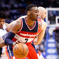 28 October 2015: Washington Wizards guard John Wall (2) drives past Orlando Magic guard Elfrid Payton (4) on a screen set by Washington Wizards center Marcin Gortat (13) during the Washington Wizards 88-87 victory over the Orlando Magic, at the Amway Center, in Orlando, Florida, USA.