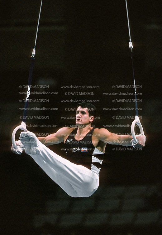 SAN JOSE, CA - JULY 17:  John Roethlisberger of the United States performs on the still rings during the Budget Rent A Car Invitational Gymnastics Meet held on July 17, 1995 at the San Jose Arena in San Jose, California.  (Photo by David Madison/Getty Images)
