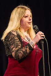 Visually impaired woman compere at concert.