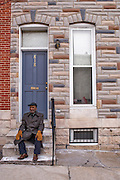 Baltimore, Maryland - March 07, 2014: Mack Jackson, 92, is a native Baltimorean, and has lived in his rowhome, three blocks from the new Henderson-Hopkins community school, for 18 years. A block from his home are blocks of rowhomes set for demolition for new townhomes.<br /> Henderson-Hopkins is a K-8 community school in East Baltimore. The school's library, gymnasium, auditorium, Early Childhood Center, and family resource center are open to the surrounding community. The school is funded through a partnership with Baltimore City, Johns Hopkins and the Harry and Jeanette Weinberg Foundation. <br /> CREDIT: Matt Roth for The New York Times<br /> Assignment ID: 30155200A