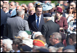 Image ©Licensed to i-Images Picture Agency. 06/06/2014. Bayeux, France, The Prime Minister David Cameron and his wife Samantha join HM The Queen and The Duke of Edinburgh accompanied by The Prince of Wales and The Duchess of Cornwall attend a service of Remembrance at the Commonwealth War Graves Cemetery at Bayeux, Normandy, France,  on the 70th anniversary of D-Day.  Picture by Andrew Parsons / i-Images