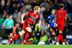 Alex Pritchard of Huddersfield Town celebrates after the game ends 1-1 giving Huddersfield Town the point needed to keep them in the Premier League and relegate Swansea City - Rogan/JMP - 09/05/2018 - FOOTBALL - Stamford Bridge - London, England - Chelsea v Huddersfield Town - Premier League.