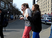 Two women comfort one another shortly after two explosions rocked Boylston Street near the Boston Marathon finish line on April 15, 2013. Three people were killed by the explosions, which occurred as about 27,000 people were competing in the marathon.