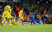 Diego Costa goes down and earns Chelsea's second penalty of the game during the Champions League match between Chelsea and Maccabi Tel Aviv at Stamford Bridge, London, England on 16 September 2015. Photo by Andy Walter.