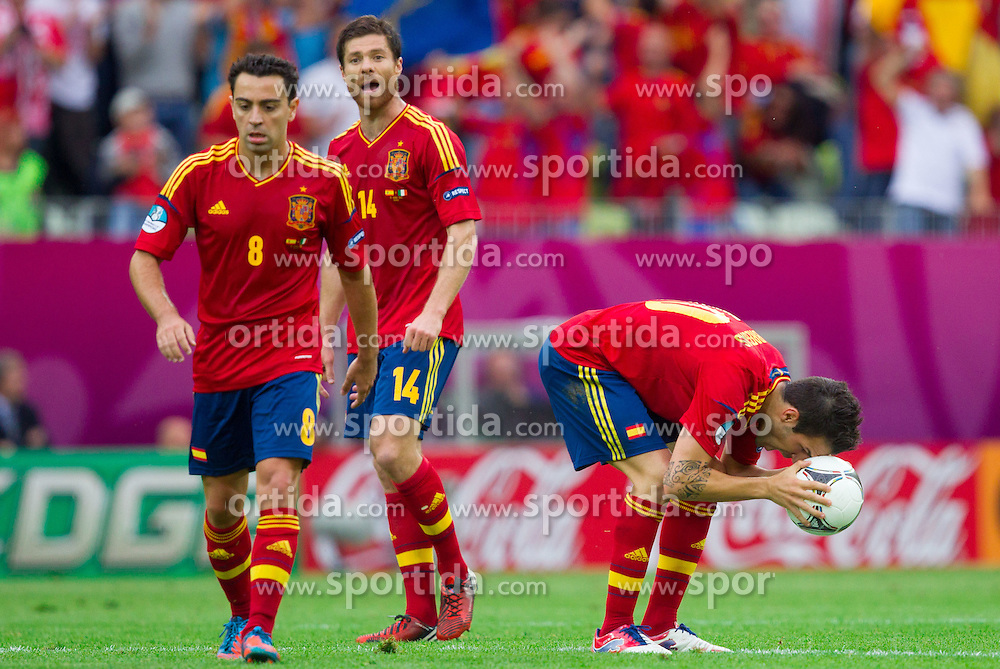 Xavi Hernandez of Spain, Xabi Alonso of Spain and Cesc Fabregas of Spain during the UEFA EURO 2012 group C match between Spain and Italy at The Arena Gdansk on June 10, 2012 in Gdansk, Poland.  (Photo by Vid Ponikvar / Sportida.com)