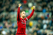 Jordan Henderson (#14) of Liverpool celebrates Liverpool's victory following the Premier League match between Newcastle United and Liverpool at St. James's Park, Newcastle, England on 4 May 2019.