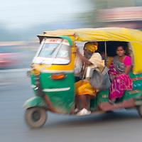 Rickshaw blurring by in Agra, India
