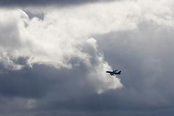 Heathrow Airport, London, March 28th 2016. A Qatar Airbus A380 departs London Heathrow as Storm Katie's clouds darken the sky.<br /> &copy;Paul Davey