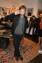 DAN STEVENS at a party to celebrate the launch of the first European John Varvatos Store, 12-13 Conduit Street, London held on 3rd September 2014.